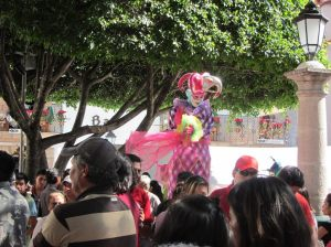 Harlequin on stilts, Taxco, Mexico