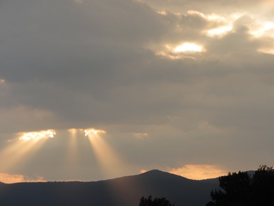 "Sun""s rays streaming through the clouds, Taxco de Alarcon, Mexcio"