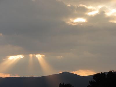 "Sun""s rays streaming through the clouds, Taxco de Alarcon, Mexcio"