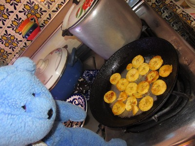 Blue Bear frying plantains