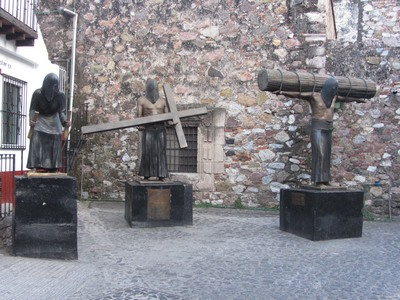 Statues of penitents, Ex-convent, Taxco, Mexico