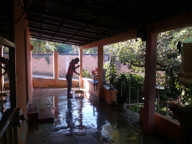 Woman washing porch, Family compound, Ocotito, Mexico