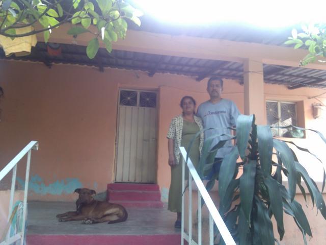 Family on front porch, El Ocotito, Mexico