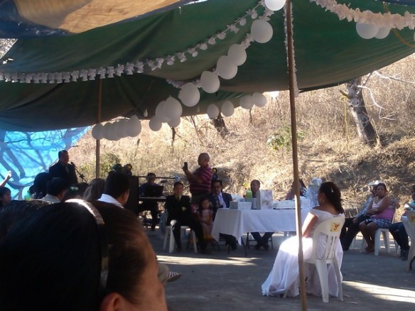 Groom sings to bride, Mexican wedding
