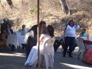 Groom kisses bride, Mexican wedding