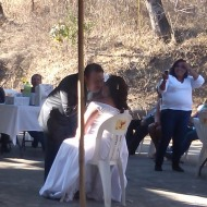 Groom kisses bride, Mexican wedding