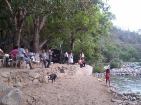 Relaxing at river at the base of Tehaucalco, Mexico