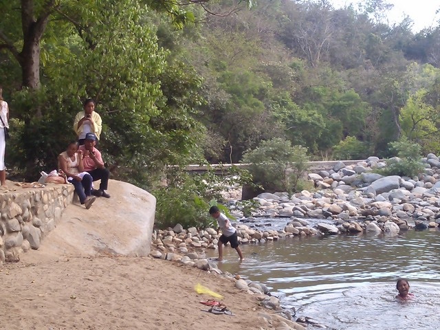 Playing in the river at the base of Tehaucalco, Mexico
